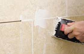Re-grouting tiles